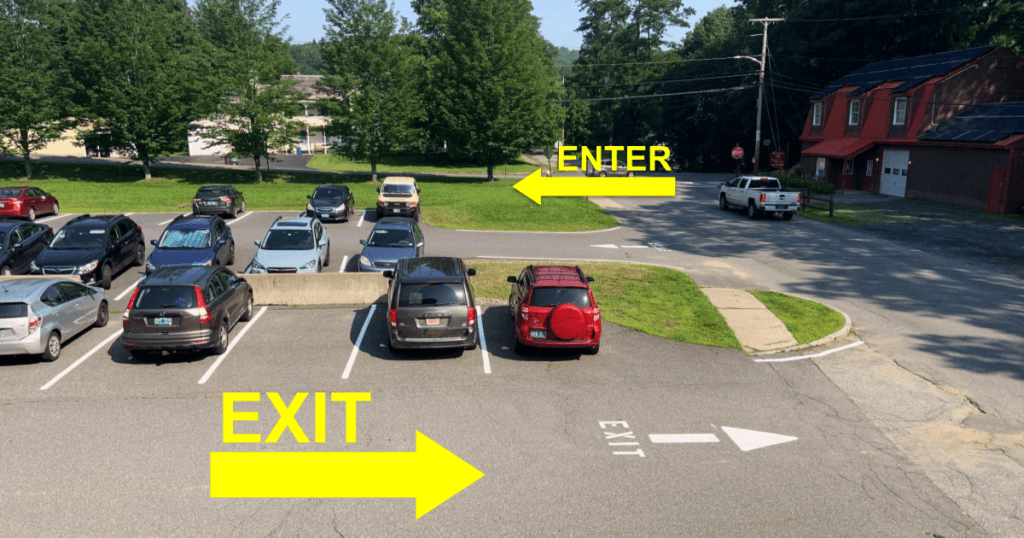 a photo of our parking lot with arrows pointing out which way to enter and exit the lot.